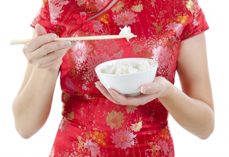 Asian oriental woman holding chopsticks and rice bowl, isolated on white background photo