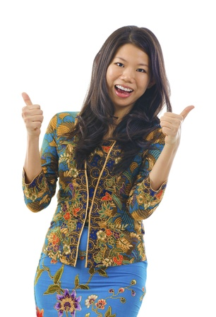 Thumbs up Asian woman in kebaya, over white background photo