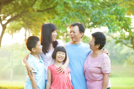 Happy Asian family having conversation at outdoor photo