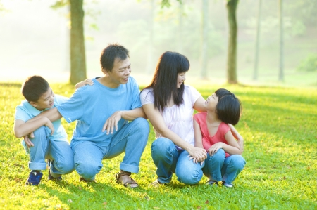 Outdoor park happy Asian family photo