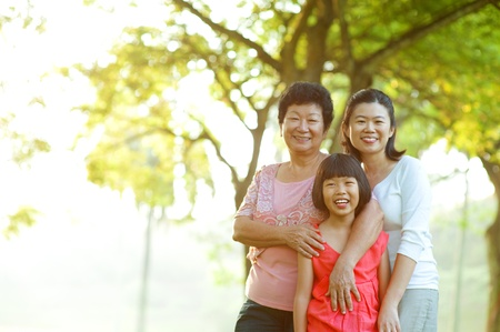 Portrait of grandmother, mother and grandchild photo