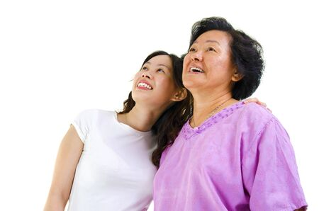 Senior Asian woman and young daughter looking away with smiling, on white background. Stock Photo - 14995342