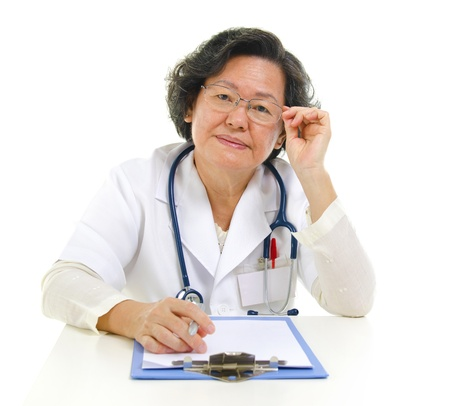 Asian senior female doctor portrait isolated on white background photo