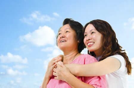 Outdoor Asian family looking over the blue sky Stock Photo - 14995340