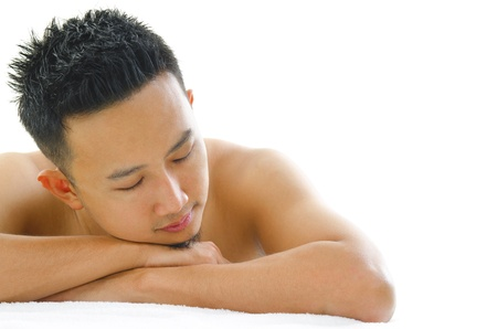 rejuvenating: Asian man having a relaxing time in beauty spa