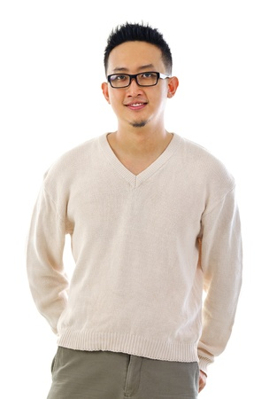 Handsome Asian male standing over white background photo