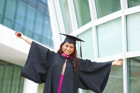 Excited Indian female graduate open arms photo