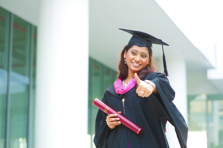 Indian female graduate giving a thumb up photo