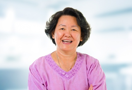 60s cheerful Asian senior woman smiling in home photo