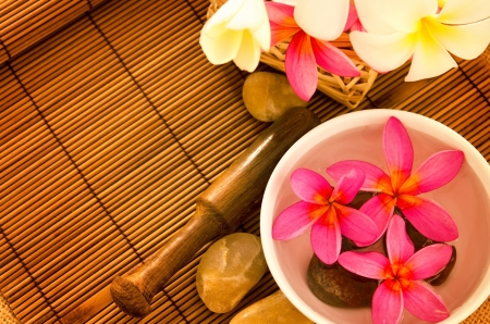 Tropical spa with Frangipani flowers on water. Low lighting, suitable for spa related theme. Stock Photo - 15121337