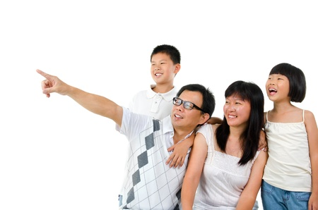 Asian family, father pointing to side over white background photo