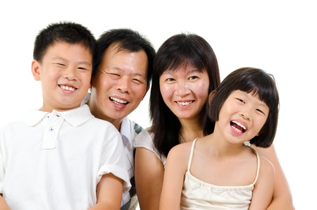 Happy Asian family laughing isolated on white background photo