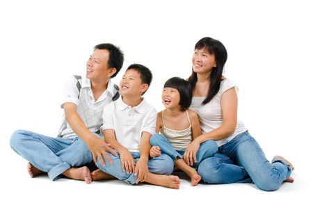 Happy Asian family looking at side, sitting on white background photo