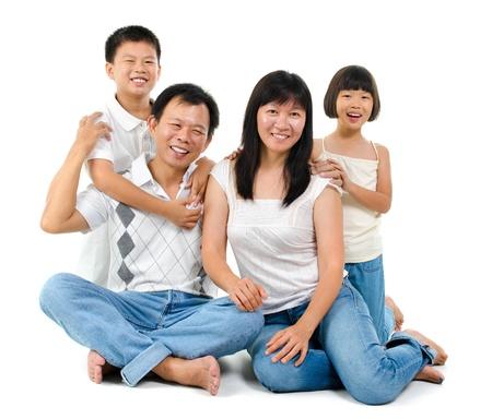 Loving Asian family on white background photo