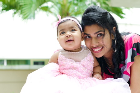 Indian mother and baby girl at outdoor home garden photo