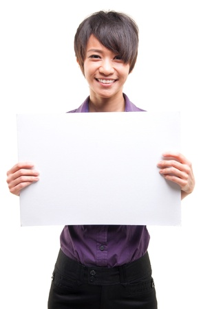 Beautiful cool Asian girl holding a white card board over white background photo
