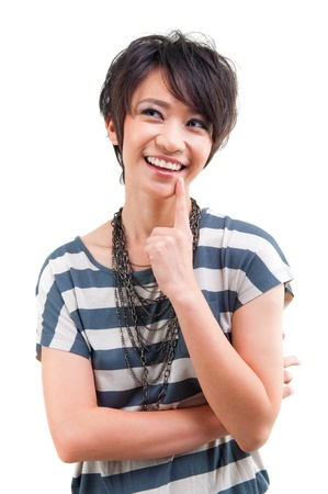 Cool Asian girl having a thought over white background photo
