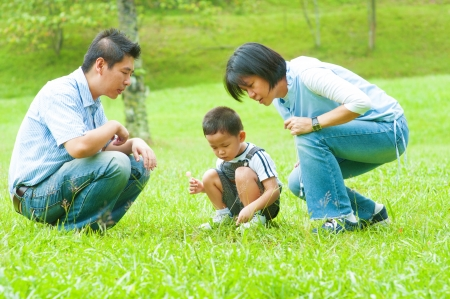 family activities: Candid Asian family at outdoors