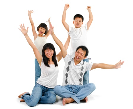 Happy Asian family arms up over white background photo