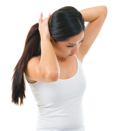 hair tie: Young Asian girl tie up her long hair over white background