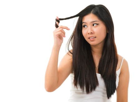 black dye: Portrait of Asian woman holding damaged dry hair and sad looking isolated on white background