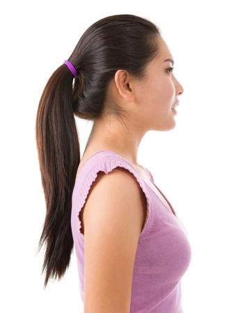 Side view of young Asian pretty lady on white background photo