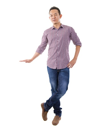 lean on hands: Full body Asian man putting hand on invisible banner over white background