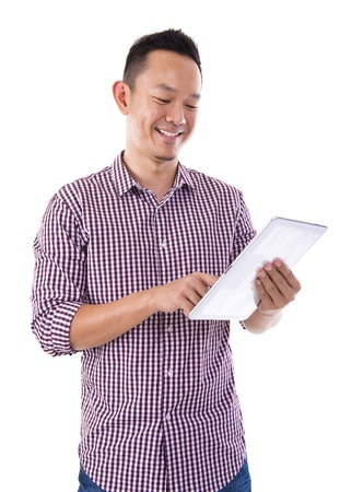 Asian man holding a digital touch screen tablet computer on white background. photo