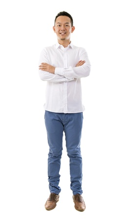 the whole body: Asian man looking at camera against white background