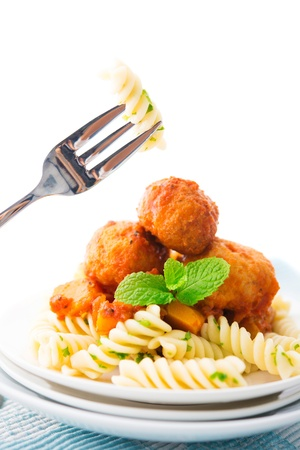 Fusilli on fork, meatball fusilli as background photo