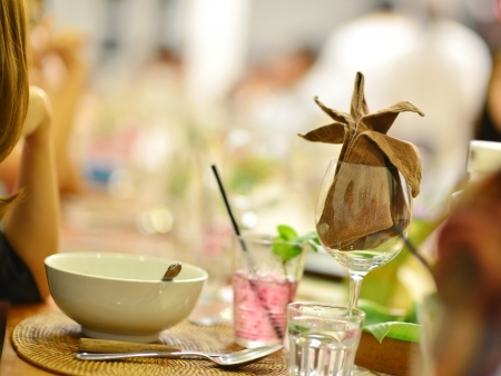 ambient: Group of people having reunion party, focus on the wineglass Stock Photo