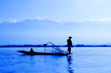 Silhouette fisherman at Inle Lake, Myanmar photo