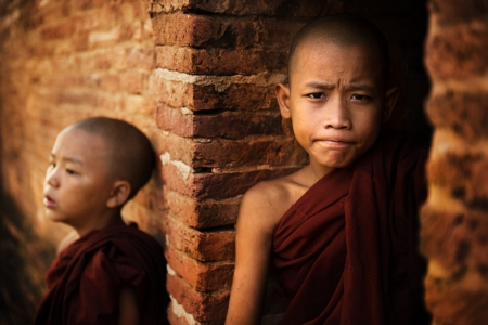 novice: Two young buddhist novice monk outside a temple background. Stock Photo