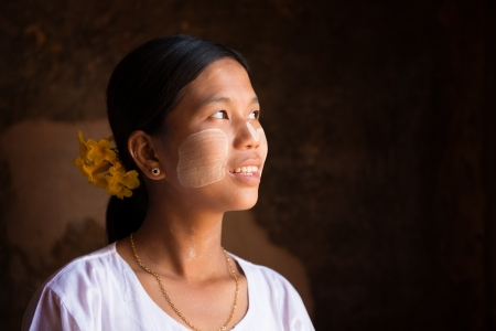 Traditional Myanmar girl is looking up to blank space Stock Photo - 16118497
