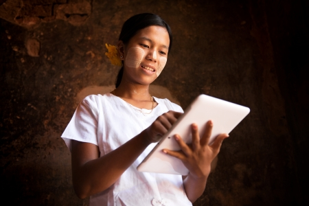 Myanmar girl using digital tablet computer. Stock Photo - 16118485