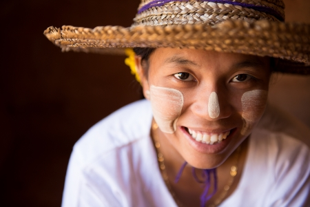 myanmar: Smiling traditional Myanmar girl in straw hat Stock Photo