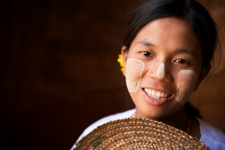Pretty Myanmar girl is smiling photo