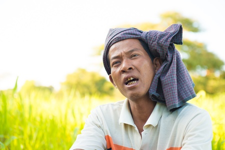 Myanmar man talking with his friend in farmland photo