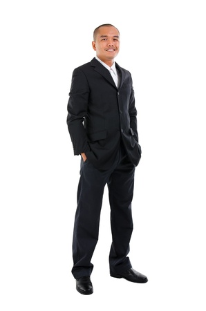 Handsome business man of Southeast Asian, full length portrait. photo