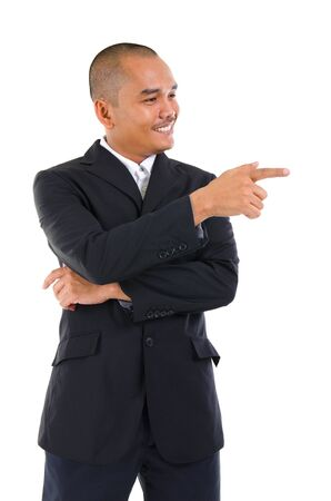 Southeast Asian man pointing to blank space photo