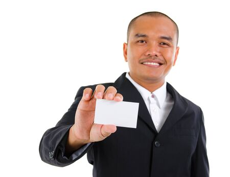 Mature Southeast Asian businessman holding business card, focus on hand over white background photo