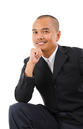 Confident Southeast Asian businessman smiling, isolated white background photo