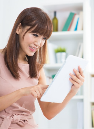 bookshelf digital: Asian female using digital tablet computer