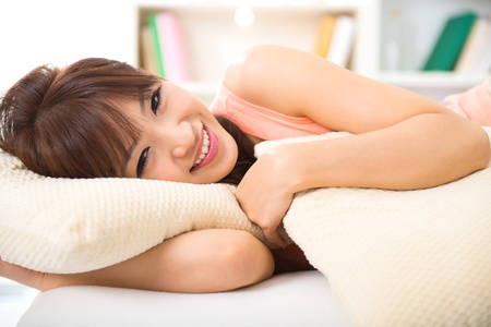 Beautiful Asian female lying on bed photo