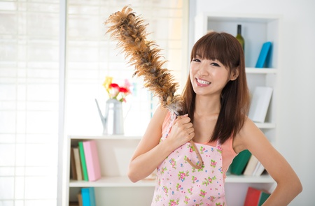 Beautiful Asian woman housekeeping with cleaning house photo