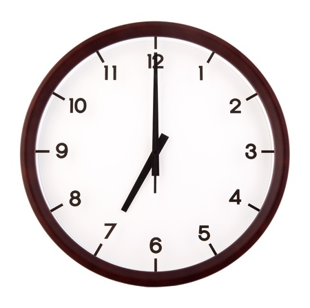 Classic analog clock pointing at 7 oclock, isolated on white background