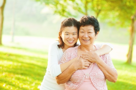senior living: Asian senior mother and adult daughter at outdoor park Stock Photo