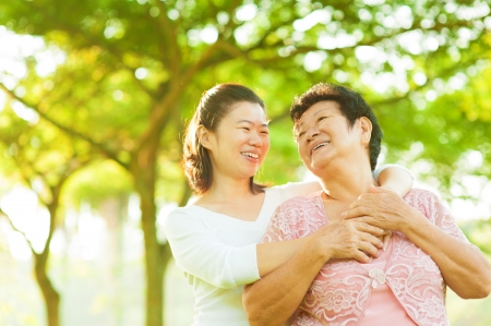outdoor living: Senior mother and daughter having fun time at outdoor
