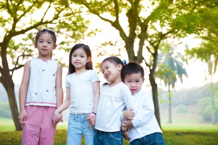 boy and girl holding hands: Asian children having fun at outdoor Stock Photo