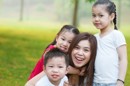 Outdoor park happy Asian mother and children Stock Photo - 16559112